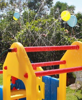 Aussie action Kids Spray Bar on a Toddler Play Gym in Garden